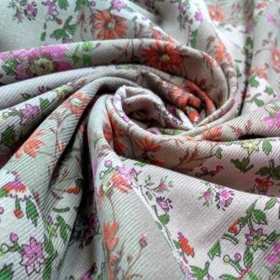Tessuto in velluttino di cotone fantasia a forellini multicolori - tortora