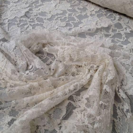 Tessuto romantico in pizzo ricamato a fantasia floreale - bianco