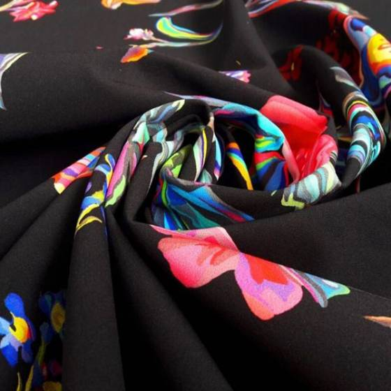 Tessuto per abbigliamento fantasia floreale esotica - fondo nero e fiori multicolor