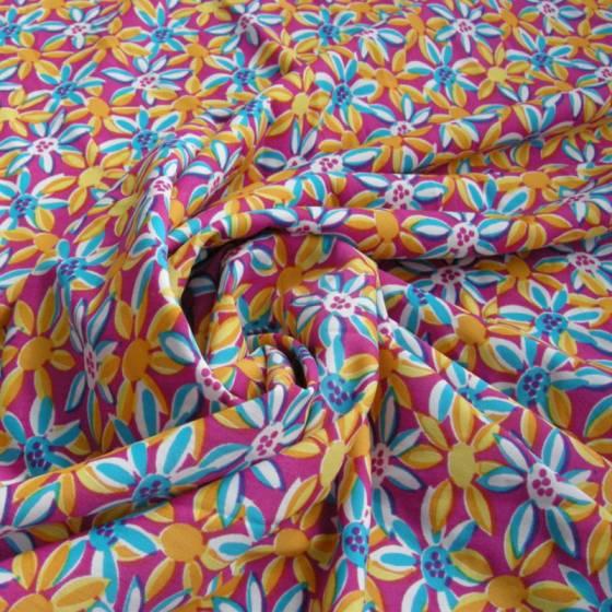 Lycra a fantasia fiorellini stilizzati colorati - sfondo fucsia