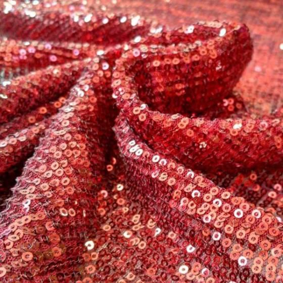 Tessuto in pizzo con paillettes elasticizzato - rame brillante