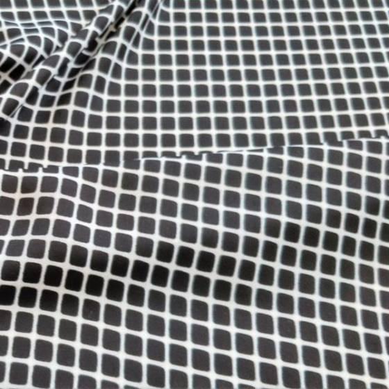 Tessuto in raso per abbigliamento fantasia optical - nero su fondo bianco