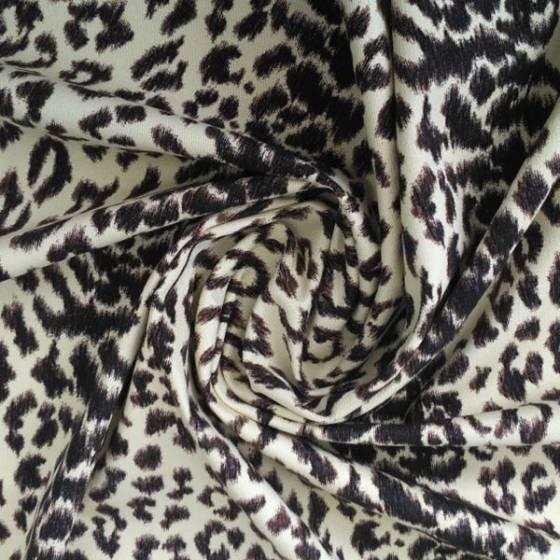 Tessuto in cotone elasticizzato a fantasia animalier - nero e giallo