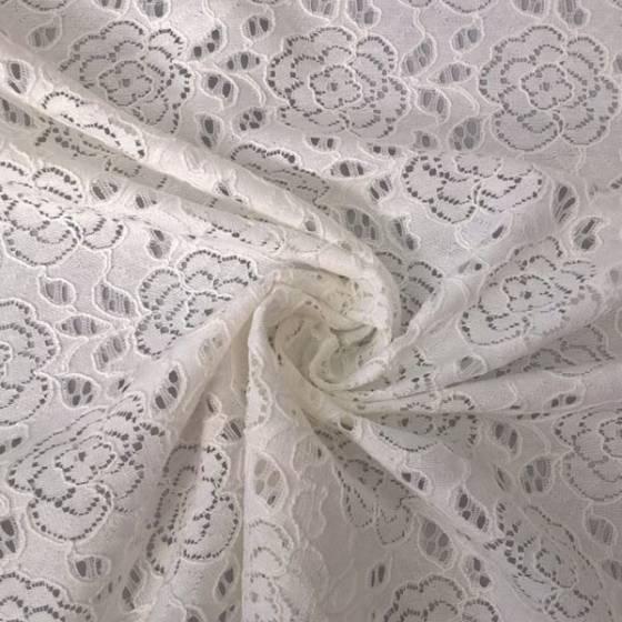 Tessuto per abiti in pizzo motivo floreale stilizzato - bianco