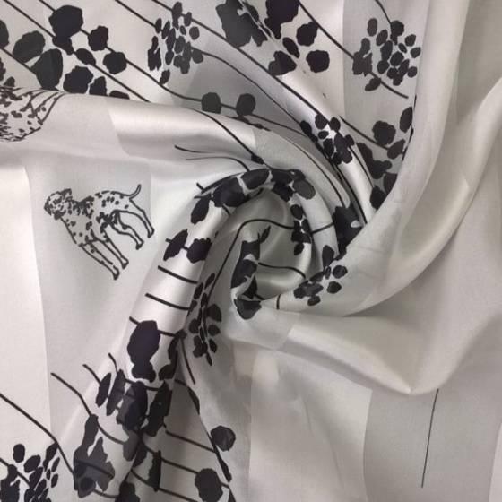 Tessuto per abiti raso di seta motivo dalmata - bianco e nero