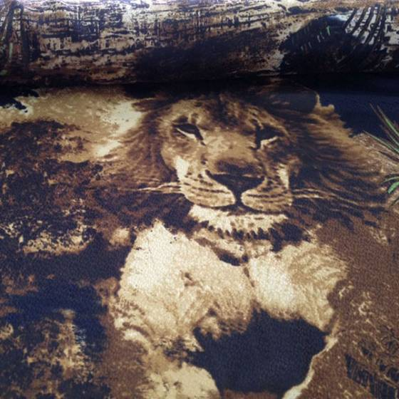 Tessuto per abiti motivo animalier - nero e marrone