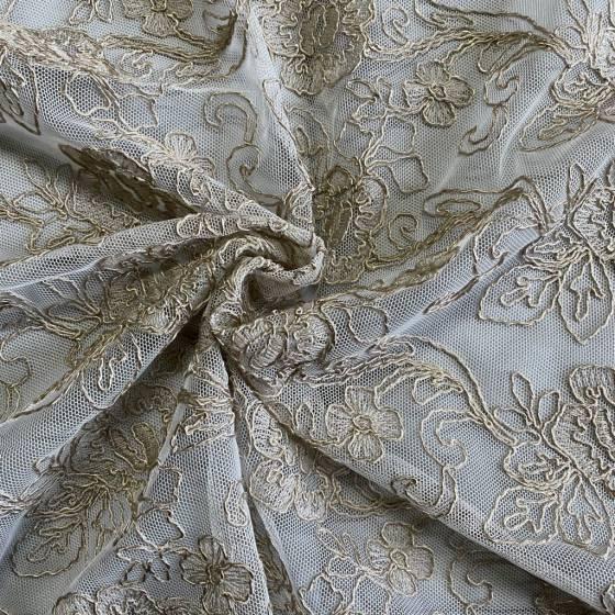 Tessuto per tendaggio a fantasia floreale con smerlo