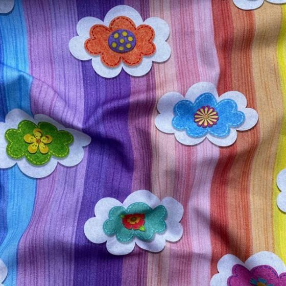 Tessuto per tendaggio per bambini a fantasia nuvolette colorate