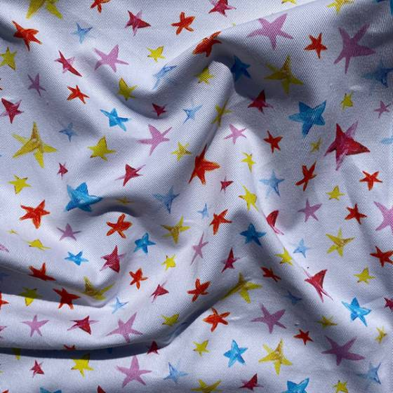 Tessuto per tendaggio con stelline colorate per bambini