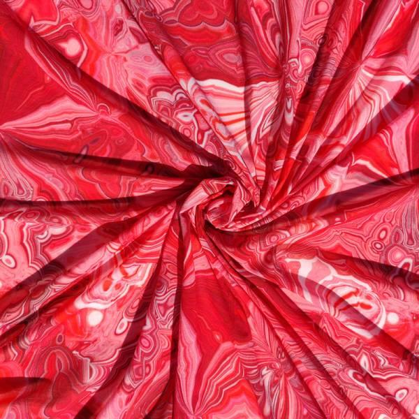 Tessuto abbigliamento fantasia astratta dai toni rossi