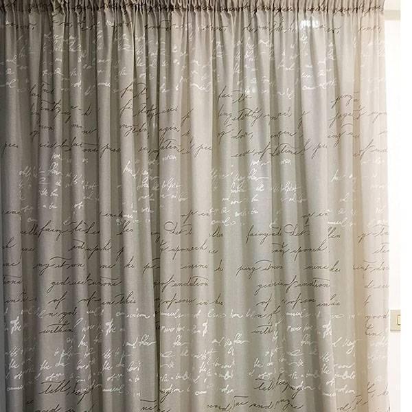 Tessuto per tendaggi misto lino con fantasia a scritte
